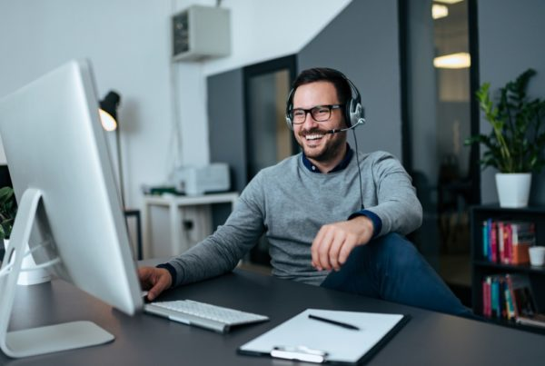 handsome casual businessman talking online via headset picture id1064570004