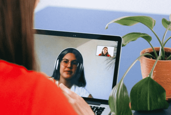 Two women video conferencing